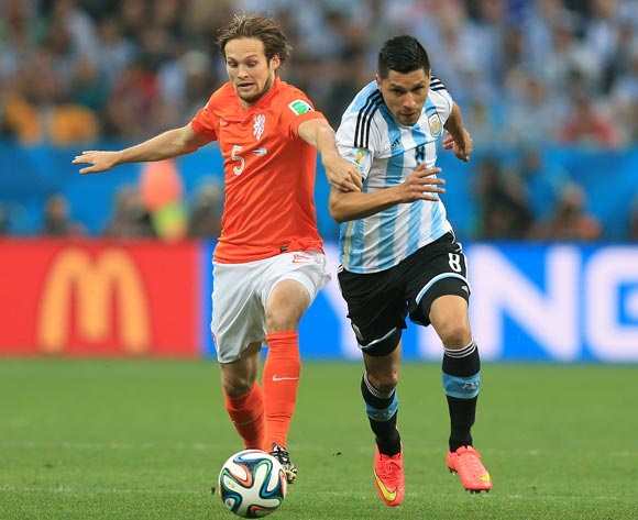 Netherlands' Daley Blind and Argentina's Enzo Perez (right) battle for the ball the FIFA World Cup Semi Final at the Arena de Sao Paulo, Sao Paulo, Brazil.