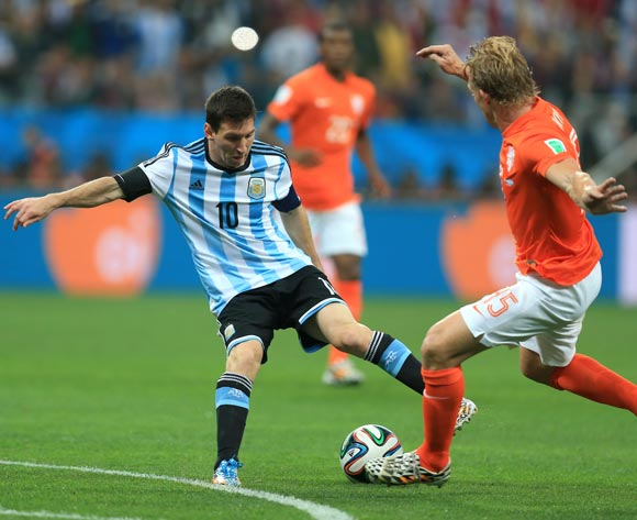 Netherlands' Dirk Kuyt and Argentina's Lionel Messi (left) battle for the ball during the FIFA World Cup Semi Final at the Arena de Sao Paulo, Sao Paulo, Brazil.