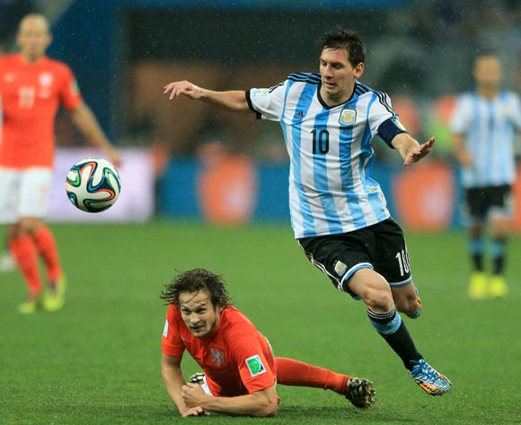Argentina's Lionel Messi (right) battles for the ball with Netherland's Daley Blind (left)