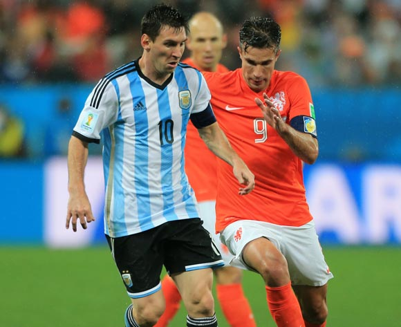 Argentina's Lionel Messi (left) and Netherland's Robin van Persie battle for the ball