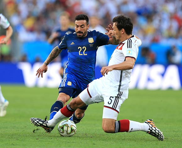 Germany's Mats Hummels and Argentina's Ezequiel Lavezzi battle for the ball during the FIFA World Cup Final at the Estadio do Maracana, Rio de Janerio, Brazil.