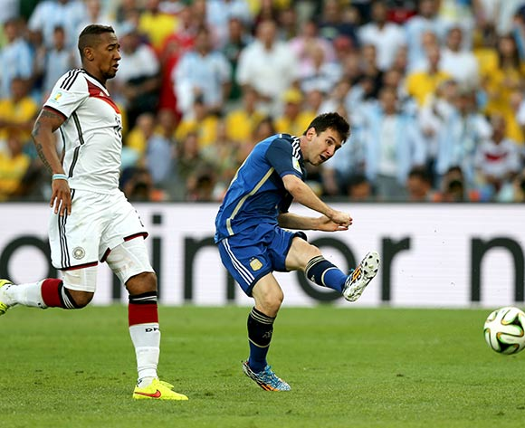 Argentina's Lionel Messi (right) has a shot on target ahead of Germany's Jerome Boateng