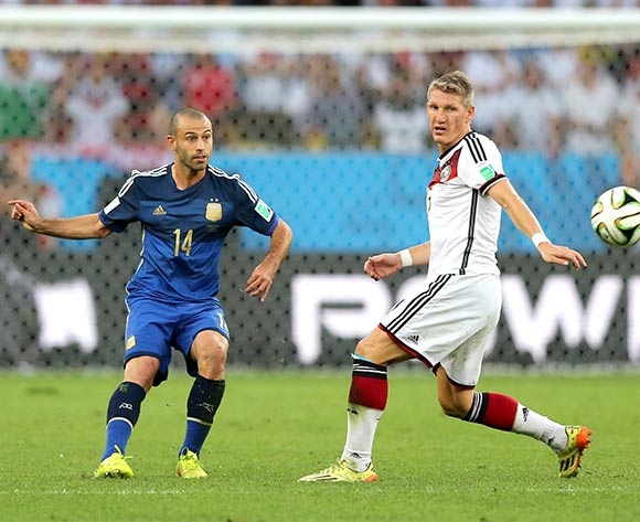 Germany's Bastian Schweinsteiger (right) and Argentina's Javier Mascherano battle for the ball