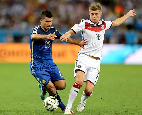 Germany's Toni Kroos (right) and Argentina's Sergio Aguero battle for the ball