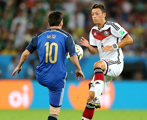 Germany's Mesut Ozil (right) and Argentina's Lionel Messi battle for the ball