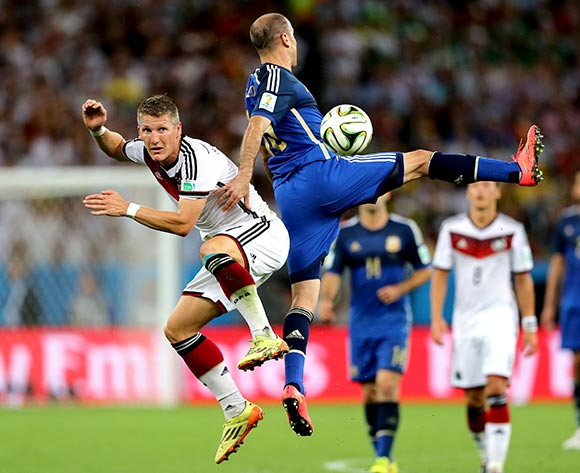 Germany's Bastian Schweinsteiger (left) and Argentina's Rodrigo Palacio battle for the ball