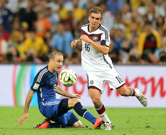 Germany's Philip Lahm (right) and Argentina's Rodrigo Palacio battle for the ball