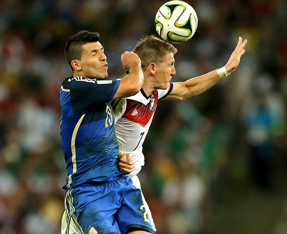 Germany's Bastian Schweinsteiger (right) collides with Argentina's Sergio Aguero