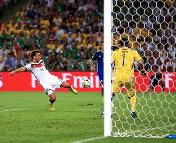 Germany's Mario Goetze scores his teams opening goal of the game