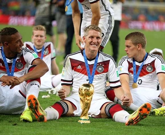 Germany's Bastian Schweinsteiger celebrates with the World Cup trophy after the FIFA World Cup Final at the Estadio do Maracana, Rio de Janerio, Brazil.