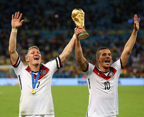 Germany's Bastian Schweinsteiger (left) and Lukas Podolski celebrate winning the World Cup after the FIFA World Cup Final at the Estadio do Maracana, Rio de Janerio, Brazil.