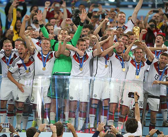 Germany's Philipp Lahm lifts the World Cup and celebrates victory with team-mates after the FIFA World Cup Final at the Estadio do Maracana, Rio de Janerio, Brazil.