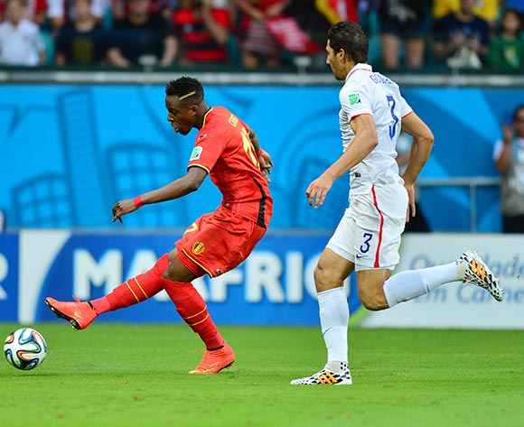 Divock Origi of Belgium shoots past Omar Gonzalez of the USA  during the 2014 Brazil World Cup Final Last 16 football match between Belgium and USA  at the Arena Fonte Nova in Salvador, Brazil on 01 July  2014