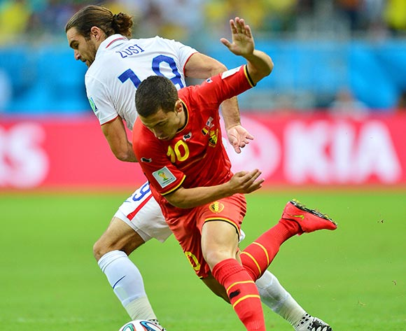 Eden Hazard of Belgium challenged by Graham Zusi of the USA  during the 2014 Brazil World Cup Final Last 16 football match between Belgium and USA  at the Arena Fonte Nova in Salvador, Brazil on 01 July  2014