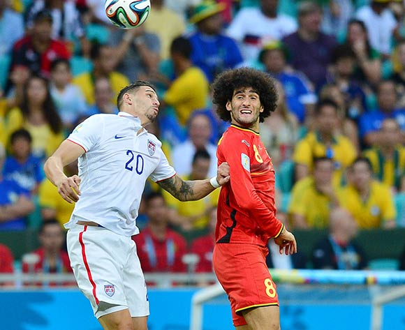 Marouane Fellaini of Belgium out jumps Geoff Cameron of the USA during the 2014 Brazil World Cup Final Last 16 football match between Belgium and USA  at the Arena Fonte Nova in Salvador, Brazil on 01 July  2014