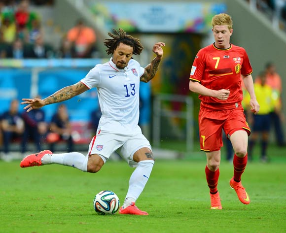 Jermaine Jones of the USA clears from Kevin De Bruyne of Belgium during the 2014 Brazil World Cup Final Last 16 football match between Belgium and USA  at the Arena Fonte Nova in Salvador, Brazil on 01 July  2014