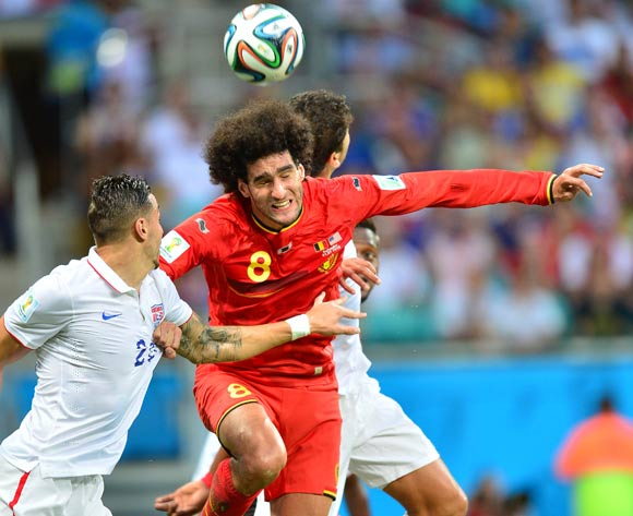 Marouane Fellaini of Belgium heads clear from Geoff Cameron of the USA during the 2014 Brazil World Cup Final Last 16 football match between Belgium and USA at the Arena Fonte Nova in Salvador, Brazil on 01 July 2014