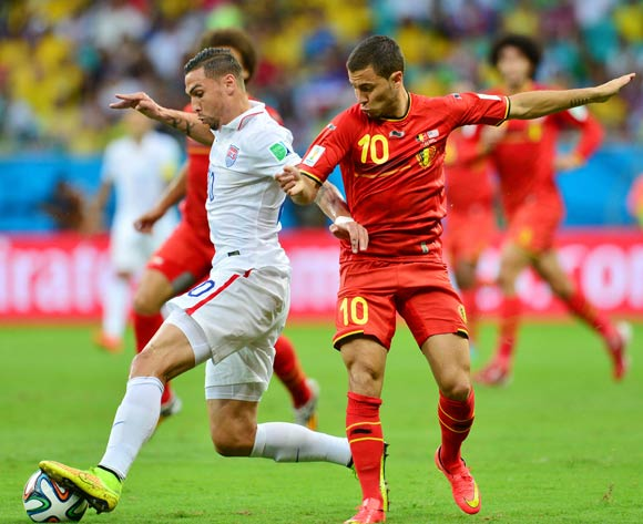 Geoff Cameron of the USA challenged by Eden Hazard of Belgium   during the 2014 Brazil World Cup Final Last 16 football match between Belgium and USA  at the Arena Fonte Nova in Salvador, Brazil on 01 July  2014