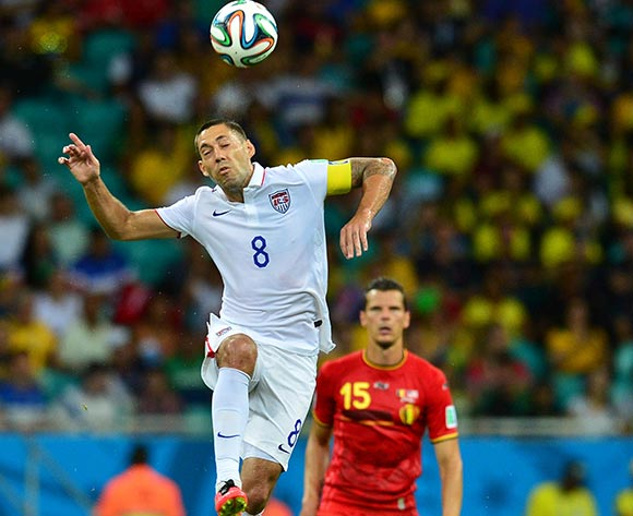 Clint Dempsey of the USA heads ball clear as Daniel Van Buyten of Belgium looks on  during the 2014 Brazil World Cup Final Last 16 football match between Belgium and USA  at the Arena Fonte Nova in Salvador, Brazil on 01 July  2014