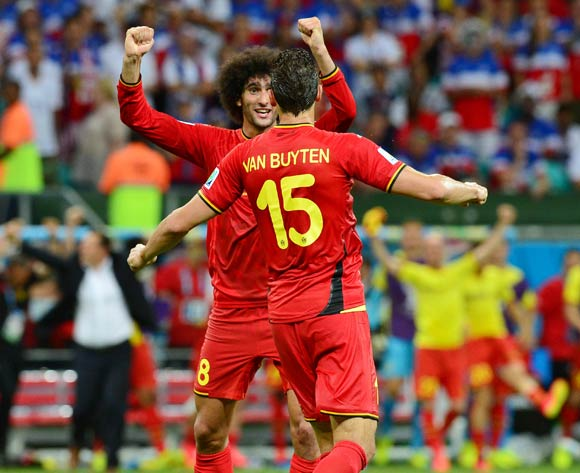 Marouane Fellaini of Belgium celebrates win with Daniel Van Buyten during the 2014 Brazil World Cup Final Last 16 football match between Belgium and USA  at the Arena Fonte Nova in Salvador, Brazil on 01 July  2014