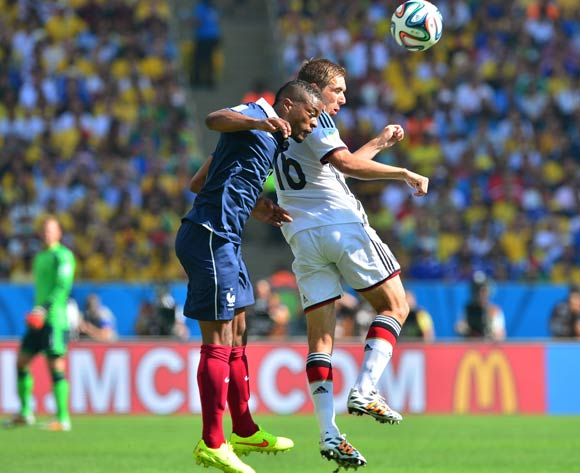 Patrice Evra of France and Philipp Lahm of Germany challenge for the ball  during the 2014 Brazil World Cup Final Quarterfinal football match between France and Germany at the Maracana Stadium in Rio De Janeiro on 4 July 2014