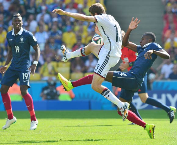 Blaise Matuidi of France clears from Thomas Mueller of Germany during the 2014 Brazil World Cup Final Quarterfinal football match between France and Germany at the Maracana Stadium in Rio De Janeiro on 4 July 2014