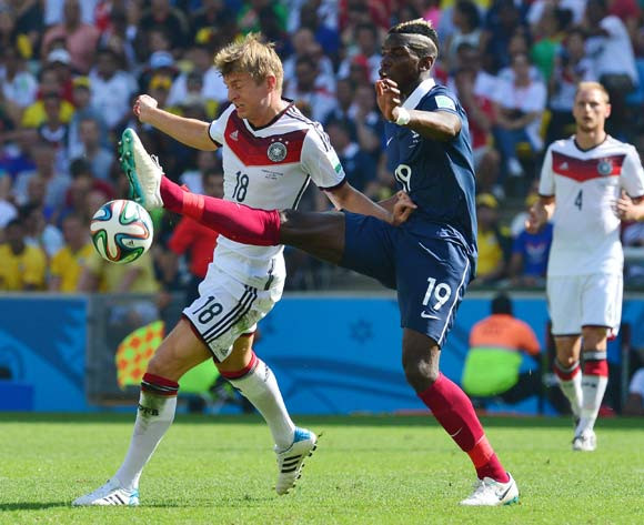 Paul Pogba of France challenges Toni Kroos of Germany  during the 2014 Brazil World Cup Final Quarterfinal football match between France and Germany at the Maracana Stadium in Rio De Janeiro on 4 July 2014