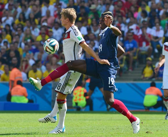Paul Pogba of France clears ball from Toni Kroos of Germany  during the 2014 Brazil World Cup Final Quarterfinal football match between France and Germany at the Maracana Stadium in Rio De Janeiro on 4 July 2014
