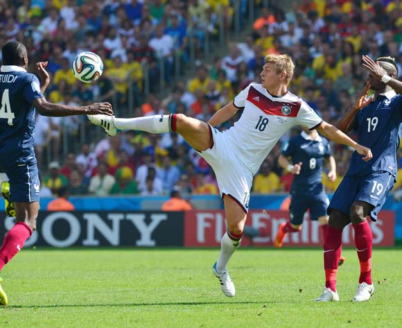 Toni Kroos of Germany  controls ball from Paul Pogba (r) Blaise Matuidi (l) during the 2014 Brazil World Cup Final Quarterfinal football match between France and Germany at the Maracana Stadium in Rio De Janeiro on 4 July 2014