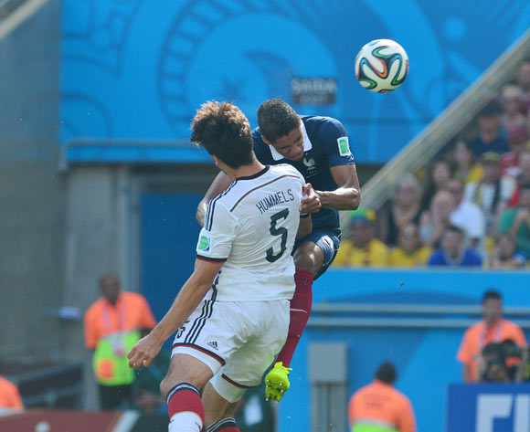Mats Hummels of Germany heads ball past Raphael Varane of France  to score during the 2014 Brazil World Cup Final Quarterfinal football match between France and Germany at the Maracana Stadium in Rio De Janeiro on 4 July 2014