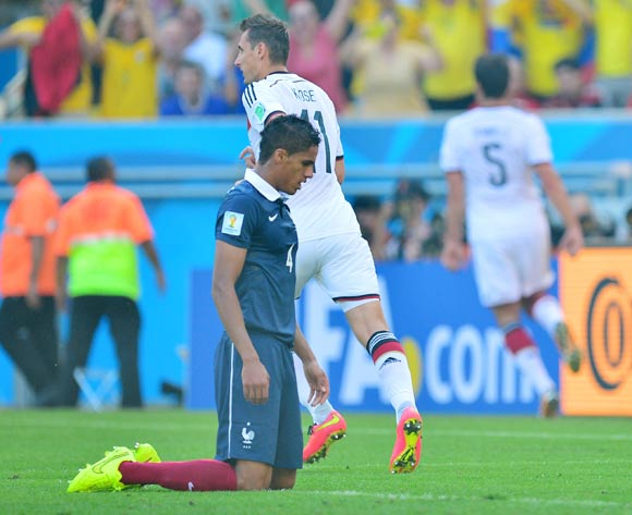 Raphael Varane of France reacts in disappointment after conceding goal as Mats Hummels of Germany (number 5) celebrates in background during the 2014 Brazil World Cup Final Quarterfinal football match between France and Germany at the Maracana Stadium in Rio De Janeiro on 4 July 2014