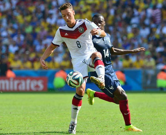 Mesut Ozil of Germany shields ball from Blaise Matuidi of France during the 2014 Brazil World Cup Final Quarterfinal football match between France and Germany at the Maracana Stadium in Rio De Janeiro on 4 July 2014