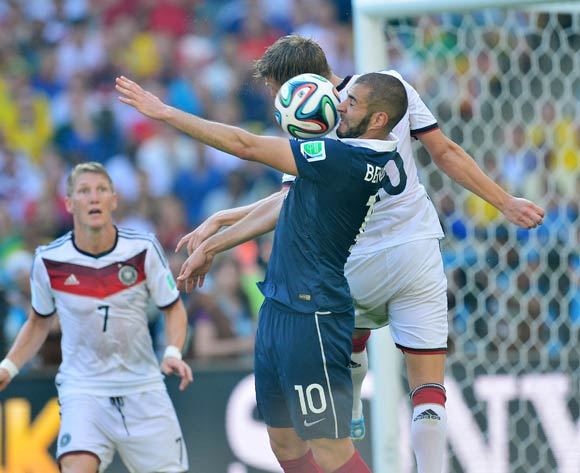 Karim Benzema of France challenged by Toni Kroos of Germany during the 2014 Brazil World Cup Final Quarterfinal football match between France and Germany at the Maracana Stadium in Rio De Janeiro on 4 July 2014