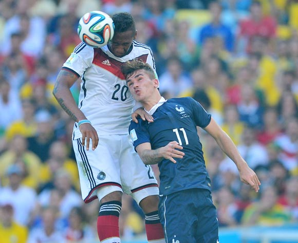 Jerome Boateng of Germany beats Antoine Griezmann of France in the air during the 2014 Brazil World Cup Final Quarterfinal football match between France and Germany at the Maracana Stadium in Rio De Janeiro on 4 July 2014