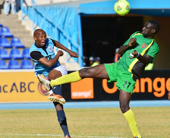 Lemponye Tshireletso of Botswana shot blocked by Arnaud Mendy of Guinea Bissau  during the 2015 African Cup of Nations football qualifier between Botswana and Guinea Bissau at the National Stadium in Gaborone on 19 July 2014