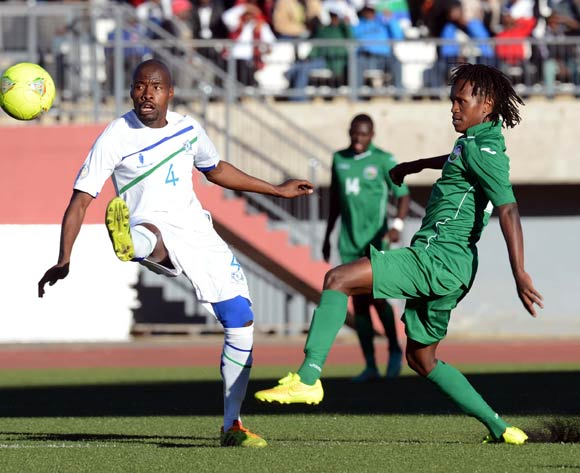 Nyambura Franas of Kenya battles with Motlalepule Mofolo of Lesotho during the AFCON Qualifier match between Lesotho and Kenya  on the 20 July 2014 at Setsoto Stadium in Maseru