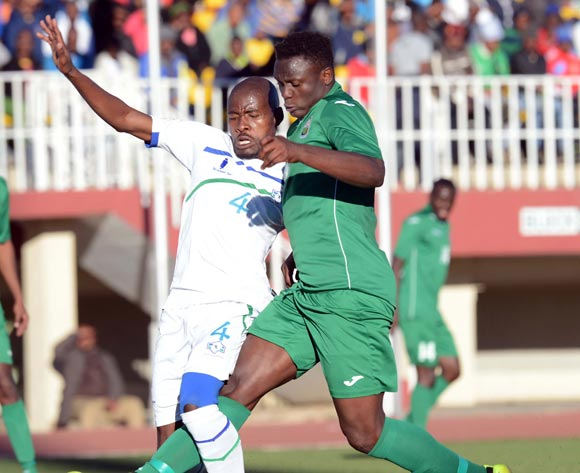 Victor Wanyama of Kenya battles with Motlalepule Mofolo of Lesotho during the AFCON Qualifier match between Lesotho and Kenya  on the 20 July 2014 at Setsoto Stadium in Maseru