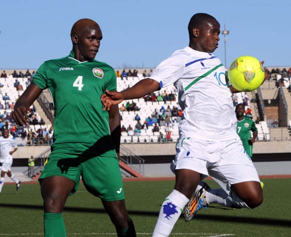 David Ochiang of Kenya battles with Jane Tsothleo of Lesotho during the AFCON Qualifier match between Lesotho and Kenya  on the 20 July 2014 at Setsoto Stadium in Maseru