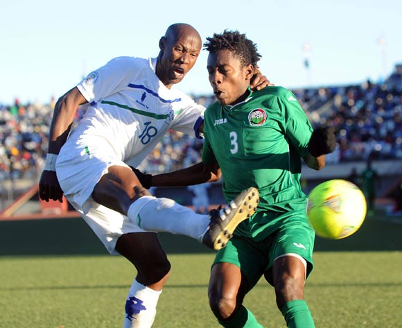 Abud Omar of Kenya battles with Nkau Lerothou of Lesotho during the AFCON Qualifier match between Lesotho and Kenya  on the 20 July 2014 at Setsoto Stadium in Maseru