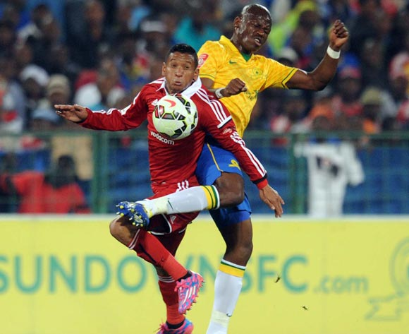 Daine Klate of Orlando Pirates tussles with Hlompho Kekana of Mamelodi Sundowns during Absa Premiership match between Mamelodi Sundowns and Orlando Pirates on the 27 August 2014 at Loftus Stadium