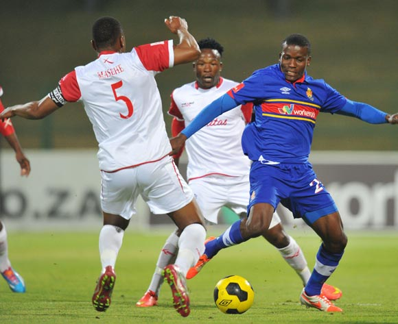 Ronald Ketjijere of University Pretoria challenged by Paulus Masehe of Free State Stars during the Absa Premiership match between University of Pretoria and Free State Stars at Tuks Stadium on the 27 August 2014