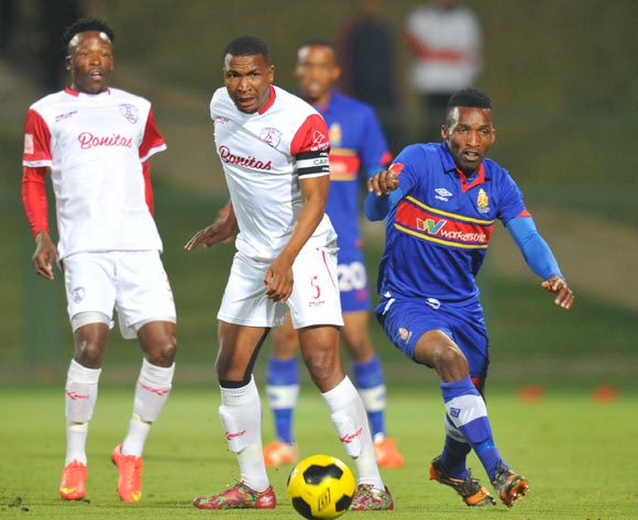 Paulus Masehe of Free State Stars challenged by Vuyisile Ntombiayithethi of University of Pretoria during the Absa Premiership match between University of Pretoria and Free State Stars at Tuks Stadium on the 27 August 2014