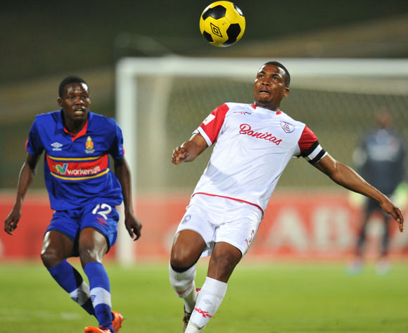 Paulus Masehe of Free State Stars challenged by Denver Mukamba of University of Pretoria during the Absa Premiership match between University of Pretoria and Free State Stars at Tuks Stadium on the 27 August 2014