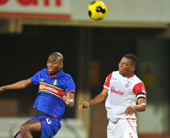 Mpho Matsi of University Pretoria challenged by Paulus Masehe of Free State Stars during the Absa Premiership match between University of Pretoria and Free State Stars at Tuks Stadium on the 27 August 2014