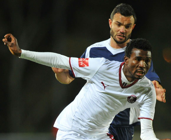 Lucky Baloyi of Moroka Swallows challenged by Dillon Sheppard of Bidvest Wits during the Absa Premiership match between Bidvest Wits and Moroka Swallows at Bidvest Stadium on the 29 August 2014