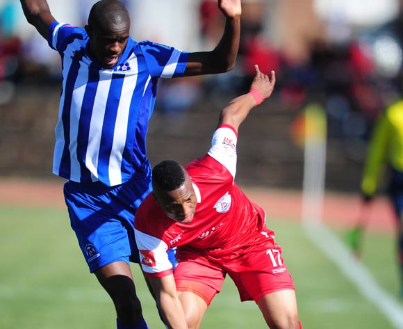Tumelo Letuka of Free State Stars battles Kwanda Mngonyama of Maritzburg United during the Absa Premiership 2014/15 football match between Free State Stars and Maritzburg United at the Goble Park Stadium in Bethlehem , Free State Province on the 30th of August 2014