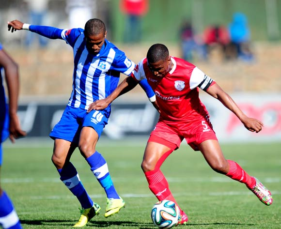 Paulus Masehe of Free State Stars battles Nhlanhla Vilakazi of Maritzburg United during the Absa Premiership 2014/15 football match between Free State Stars and Maritzburg United at the Goble Park Stadium in Bethlehem , Free State Province on the 30th of August 2014