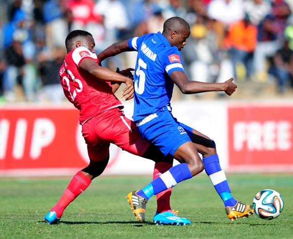 Kwanda Mngonyama of Maritzburg United battles Moeketsi Sekola of Free State Stars during the Absa Premiership 2014/15 football match between Free State Stars and Maritzburg United at the Goble Park Stadium in Bethlehem , Free State Province on the 30th of August 2014