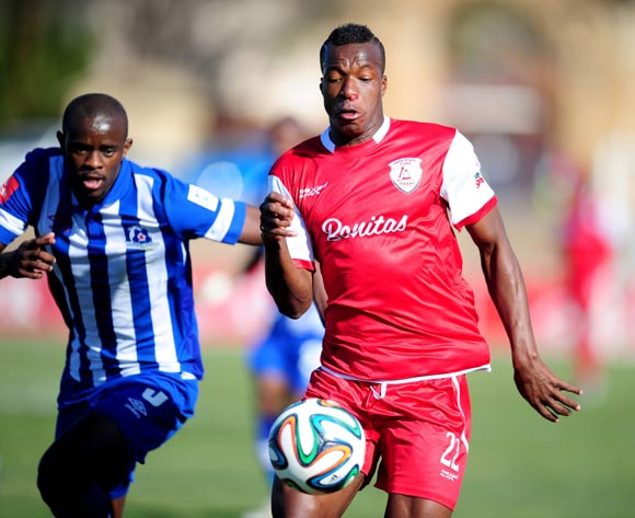 Camaldine Abraw of Free State Stars and Kwanda Mngonyama of Maritzburg United during the Absa Premiership 2014/15 football match between Free State Stars and Maritzburg United at the Goble Park Stadium in Bethlehem , Free State Province on the 30th of August 2014