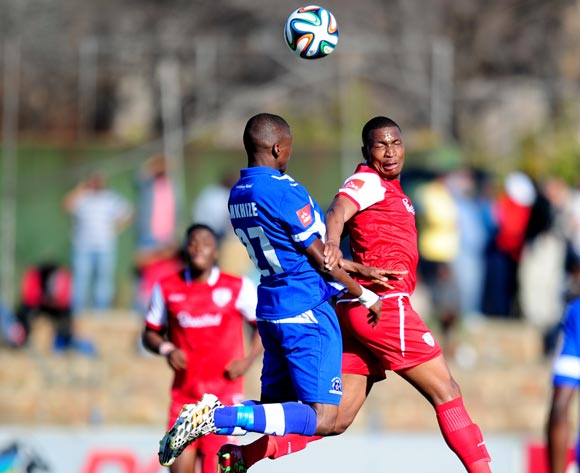 Paulus Masehe of Free State Stars challenged by Thamsanqa Mkhize of Maritzburg United during the Absa Premiership 2014/15 football match between Free State Stars and Maritzburg United at the Goble Park Stadium in Bethlehem , Free State Province on the 30th of August 2014